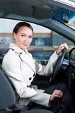 Woman in a car Stock Images