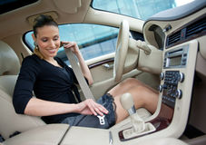 Woman in the car Stock Images