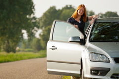 Woman with a car Stock Image