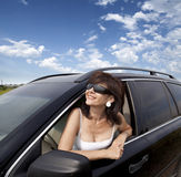 The woman and the car Royalty Free Stock Images