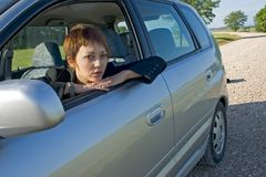 Woman in the car. Young woman with a modern car of gray color Royalty Free Stock Photo