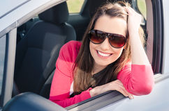 Woman in car. Woman Sitting In Car Getting Ready To Drive Stock Images