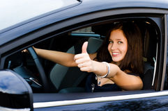 Woman in the car. Smiling cute girl in the black car Stock Photo