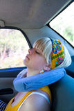 Woman in car. Woman sleeping in a car with inflatable pillow Stock Photography