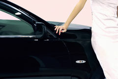 Woman and car. Woman standing next to car stock image