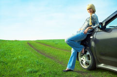 Woman and car Stock Photos