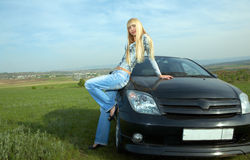 Woman with car Stock Photo