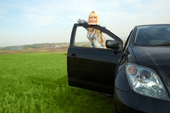 Woman with car Stock Photography