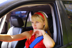 Woman in the car stock photos