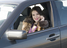 Woman in car Stock Image