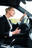 Woman in car being angry cursing other driver Royalty Free Stock Photo