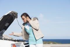 Woman car break down assistance royalty free stock image