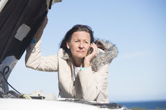 Woman car break down phone assistance Stock Image