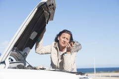 Woman car break down phone assistance Royalty Free Stock Photography