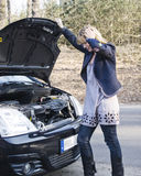 Woman car breakdown Stock Photography