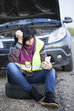 Woman car broke down on the empty road Royalty Free Stock Image