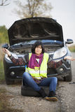 Woman car broke down on the empty road Stock Photography