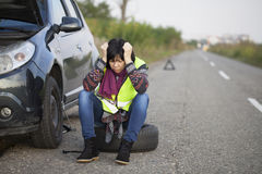 Woman car broke down on the empty road Stock Images