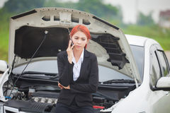 Woman with car broke down Royalty Free Stock Photography