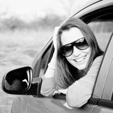 Woman in car BW. Woman Sitting In Car Getting Ready To Drive. Black and white image stock photo