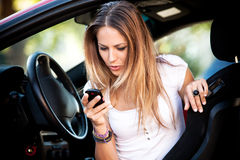 Woman in car dial cell phone  Stock Photo