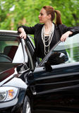Woman at car door Royalty Free Stock Images