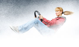 Woman car driver, concept of winter driving. With background Stock Images