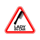 Woman car driver sticker. Female in automobile warning sign. Lady hairbruch comb in red triangle to a vehicle glass. Stock Images