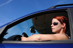 Woman, car, driving Stock Images