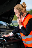 Woman with car engine problems calling repair service Stock Photos