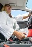 Woman in a car holding the handbrake Stock Photo