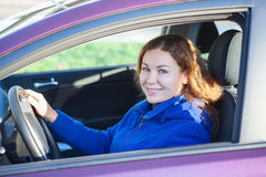 Woman in car holding steering wheel Stock Image