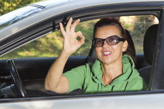 Woman in the car indicating ok sign Stock Image