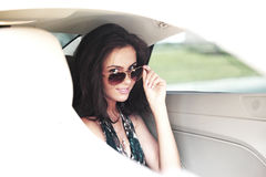 Woman in car interior Stock Image
