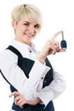 Woman with car key Stock Images