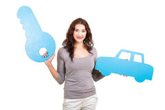 Woman car key. Pretty young woman holding paper car and key symbol isolated on white Stock Images