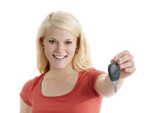 Woman with car keys. Happy young blond woman with car keys stock photos
