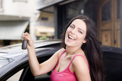 Woman with car keys. Happy young woman smiling with car keys stock photo