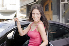 Woman with car keys stock images