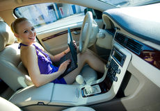 Woman in the car with laptop Royalty Free Stock Photos