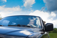 The woman in a car Royalty Free Stock Image