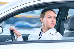 Woman in a car is looking back Royalty Free Stock Photos