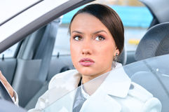 Woman in a car is looking upwards Stock Image