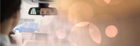 Woman in car with magical lights transition effect and mirror Stock Photos