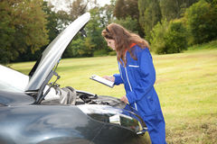 Woman car mechanic in action Stock Images