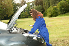 Woman car mechanic in action Royalty Free Stock Photo