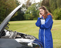 Woman car mechanic in action Royalty Free Stock Images