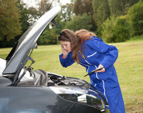 Woman car mechanic in action Royalty Free Stock Photos