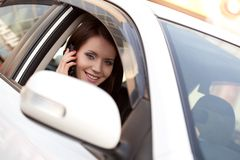 Woman in car with mobile phone Royalty Free Stock Image