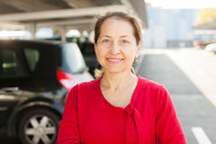 Woman   at car parking lot. Stock Images
